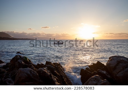 boat at sunset in cefal�¹ italy - stock photo