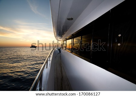 Boat At The Sunset - stock photo