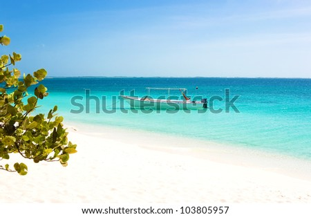 Boat at the tropical beach of archipelago Los Roques, Venezuela - stock photo