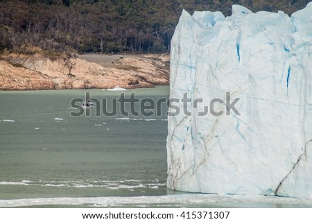 Boat by Perito Moreno glacier, Los Glaciares National Park, Patagonia, Argentina - stock photo