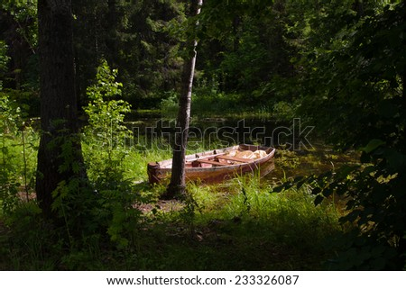 boat by the river - stock photo