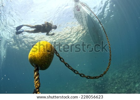 boat chain anchor from underwater - stock photo