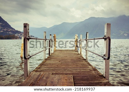 Boat dock in Lugano, Switzerland. Nautical, travel, European vacation, boating and yachting concept. High contrast. Vintage processed  - stock photo