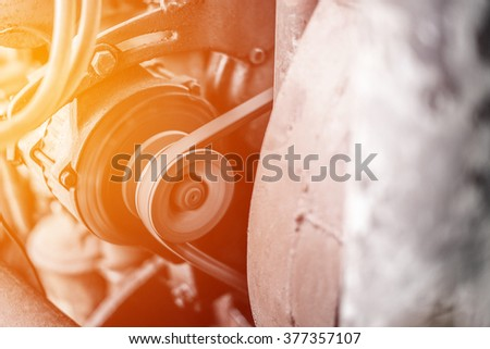 Boat engine closeup, focus on pulley - stock photo