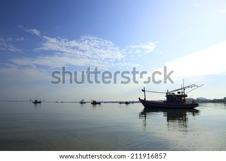 Boat fishing during the sun rises in the morning - stock photo