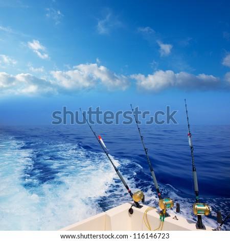 boat fishing trolling in deep blue ocean offshore in Mediterranean sea - stock photo