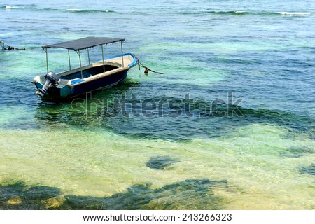 Boat floating in tropical se. Sri lanka - stock photo