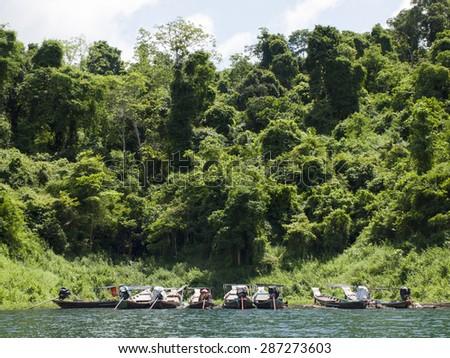 boat floats near the shore  - stock photo