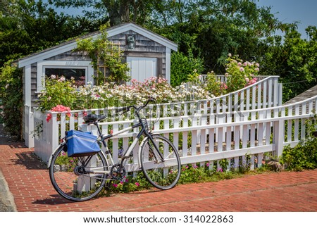 Boat house and bicycle in Martha's Vineyard - stock photo