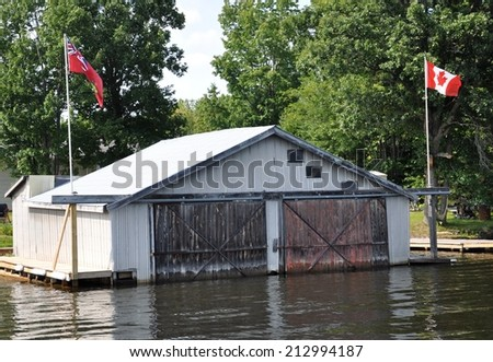 Boat house in Canada - stock photo