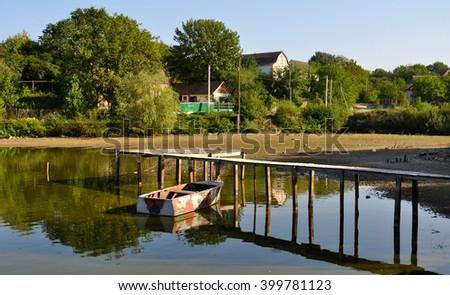 boat in dry pond - stock photo