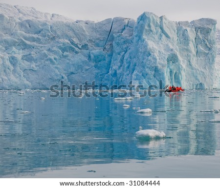 Boat in fjord with glacier, Arctic, Spitsbergen - stock photo