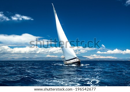 Boat in sailing regatta. - stock photo