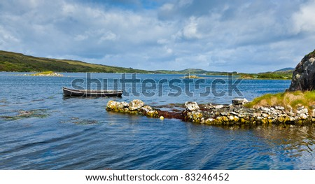 Boat in summer at Ardmore bay, county Galway, Ireland. - stock photo