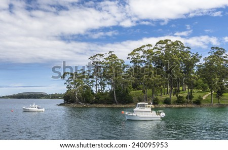 Boat in the bay of Port Arthur, Tasmania. - stock photo