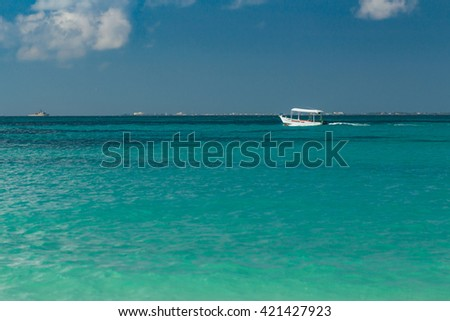Boat in the Caribbean Sea. Turquoise sea water. The small ship in the sea. - stock photo