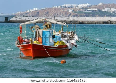 Boat in the port of Mykonos, Greece - stock photo