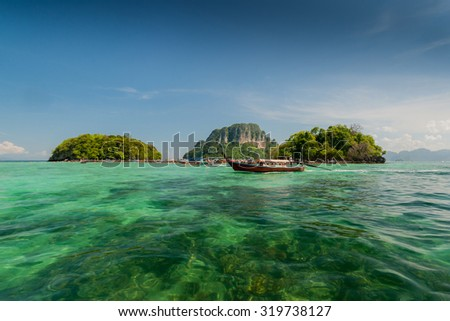 Boat in the sea and blue sky Krabi, Thailand - stock photo