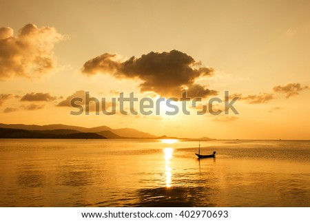 boat in the sea sunset background - stock photo