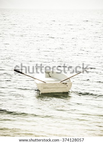 boat in the water, monochrome - stock photo