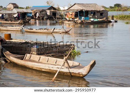 Boat mooring at home. Lake of Cambodia, the Tonle Sap. Hundreds of floating houses are located on the water. In these people live permanently. This way of life has become normal for them. - stock photo