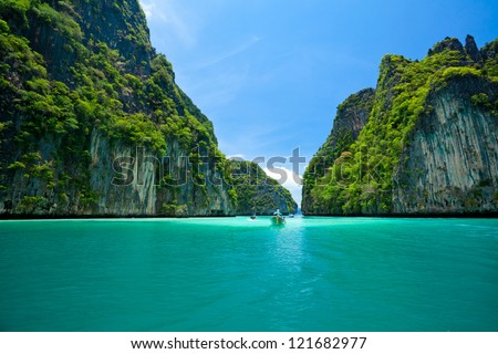 boat moving in sea Phi Phi Leh south of Thailand - stock photo