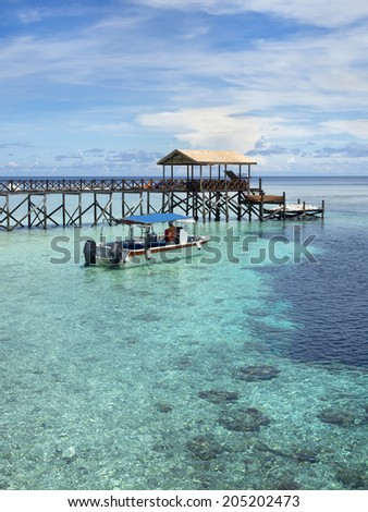 Boat next to pier at world famous Pulau Sipadan island in Sabah, East Malaysia. - stock photo