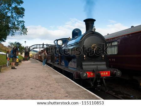 BOAT OF GARTEN, SCOTLAND - OCT 7: Caley 828, the world's only surviving Caledonian Railway's 0-6-0 tender locomotive on October 7, 2012 in Boat Of Garten, Scotland - stock photo