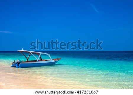 boat on a beautiful tropical beach. vacation background - stock photo