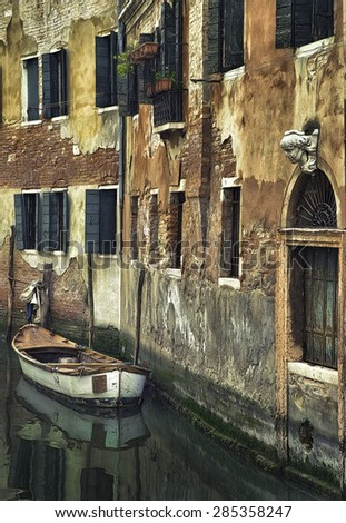 Boat on a Narrow Side Canal in Venice Italy - stock photo