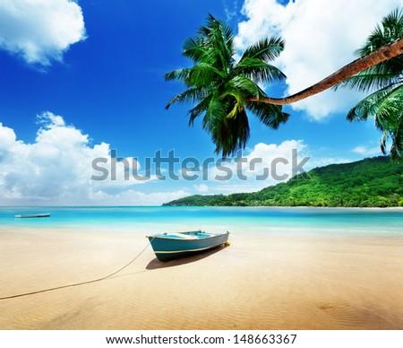 boat on beach Mahe island, Seychelles - stock photo