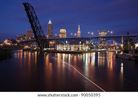 Boat on Cuyahoga River in downtown of Cleveland - stock photo