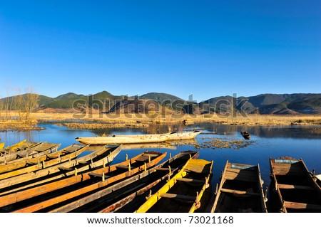 boat on Lugu Lake - stock photo
