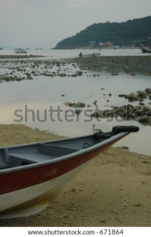 boat on the beach - stock photo