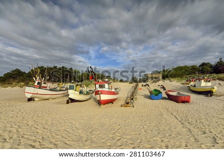 Boat on the beach at sunrise time, Baltic Sea, Debki, Poland - stock photo
