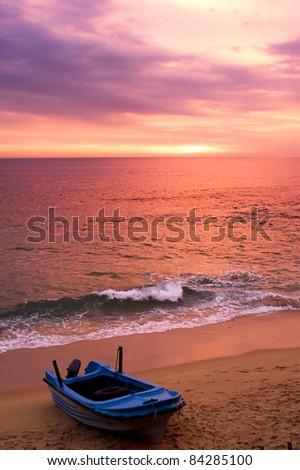 Boat on the beach at sunset. Sri Lanka - stock photo