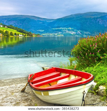 Boat on the beach, Norway fjords. Norwegian village Olden. - stock photo