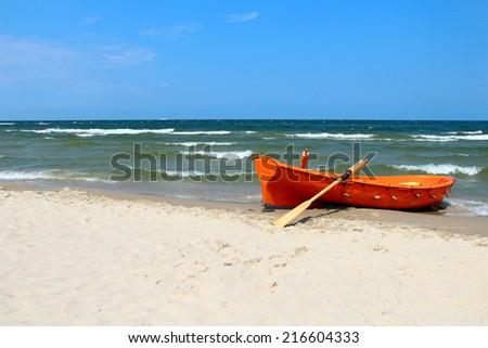 Boat on the beach of Baltic sea in Swinoujscie, Poland - stock photo