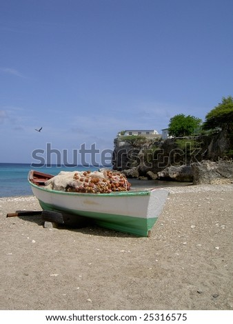 Boat on the caribbean island curacao - stock photo
