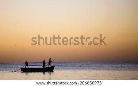 Boat on the lagoon in Mont-Choisy beach, Mauritius island, indian ocean. - stock photo