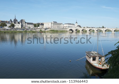 Boat on the River Loire in the town of Saumur, Loire Valley, France - stock photo