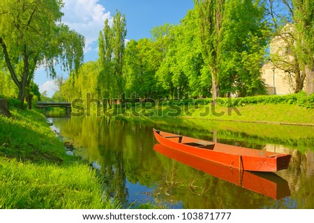 Boat on the river. Spring landscape. - stock photo