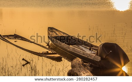 Boat on the shore lake - stock photo
