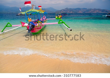 Boat on the tropical beach - stock photo