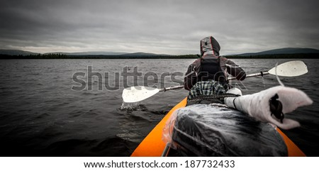 boat on the water before the storm - stock photo