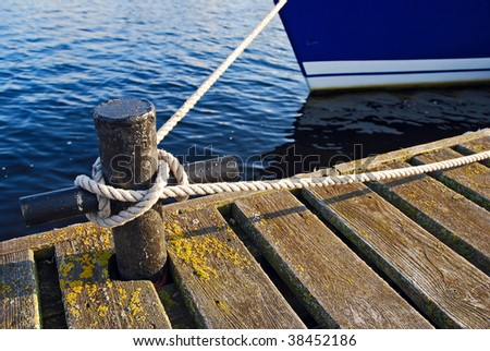 Boat pier tie - stock photo