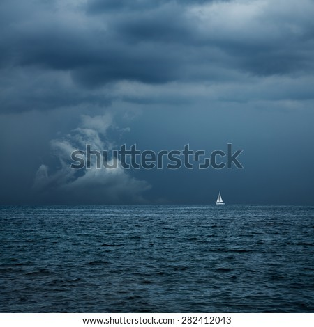 Boat Sailing in Center of Storm Formation. Dramatic Background. Danger in Sea Concept. Toned Photo with Copy Space. - stock photo