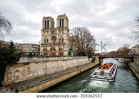 Boat sailing on the Seine near Notre Dame - stock photo