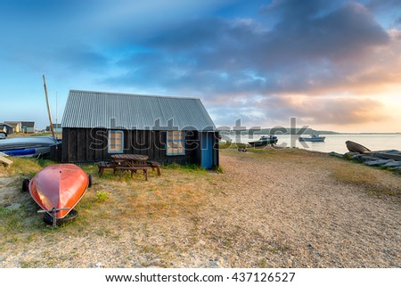 Boat sheds and beach huts at Mudeford Spit in Christchurch harbour on the Dorset coast - stock photo