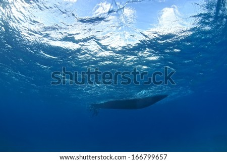 Boat silhouette under water, Hawaii. - stock photo